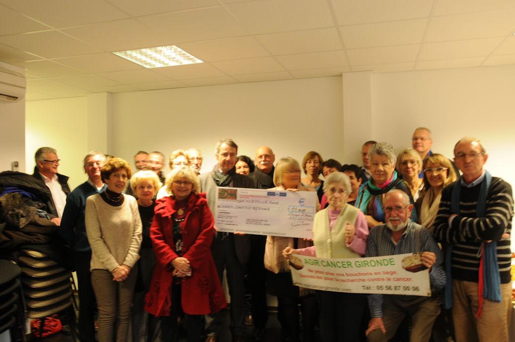 13 décembre 2013 : remise d'un chèque de 18 000 € à l'Institut Bergonié